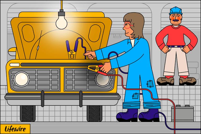 Car mechanic jump starting an automotive battery