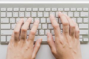 Hands tying on a keyboard