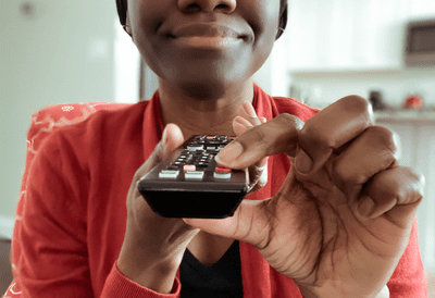 Image of a woman using an IR remote control