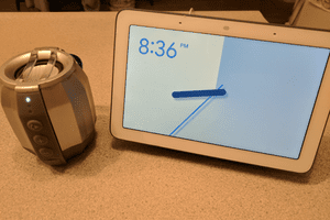 A Google Home hub and a Bluetooth speaker