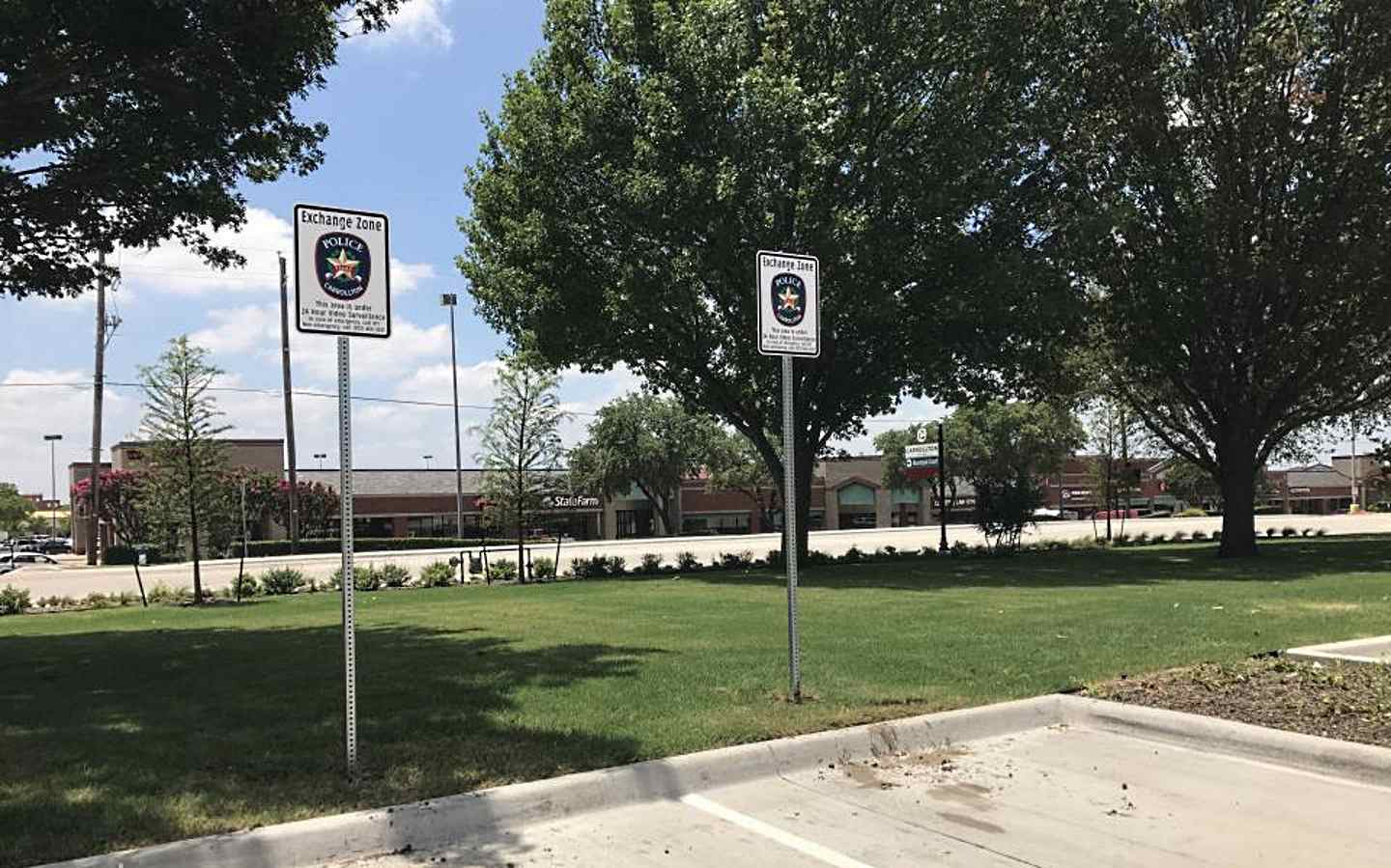 A picture of two safe exchange parking spots at a police station.