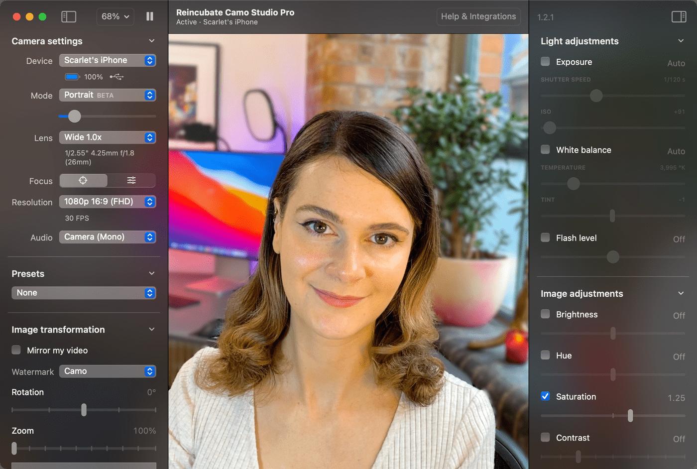 Someone using the Camo app with a MacBook webcam.