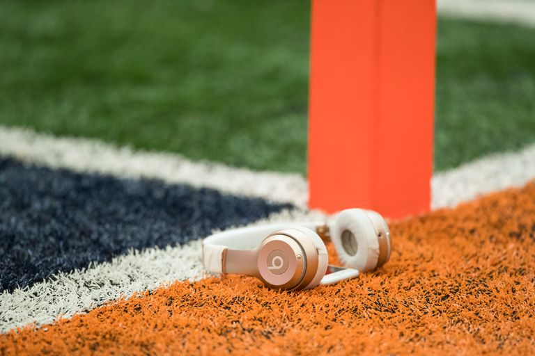 Beats headphones on football field