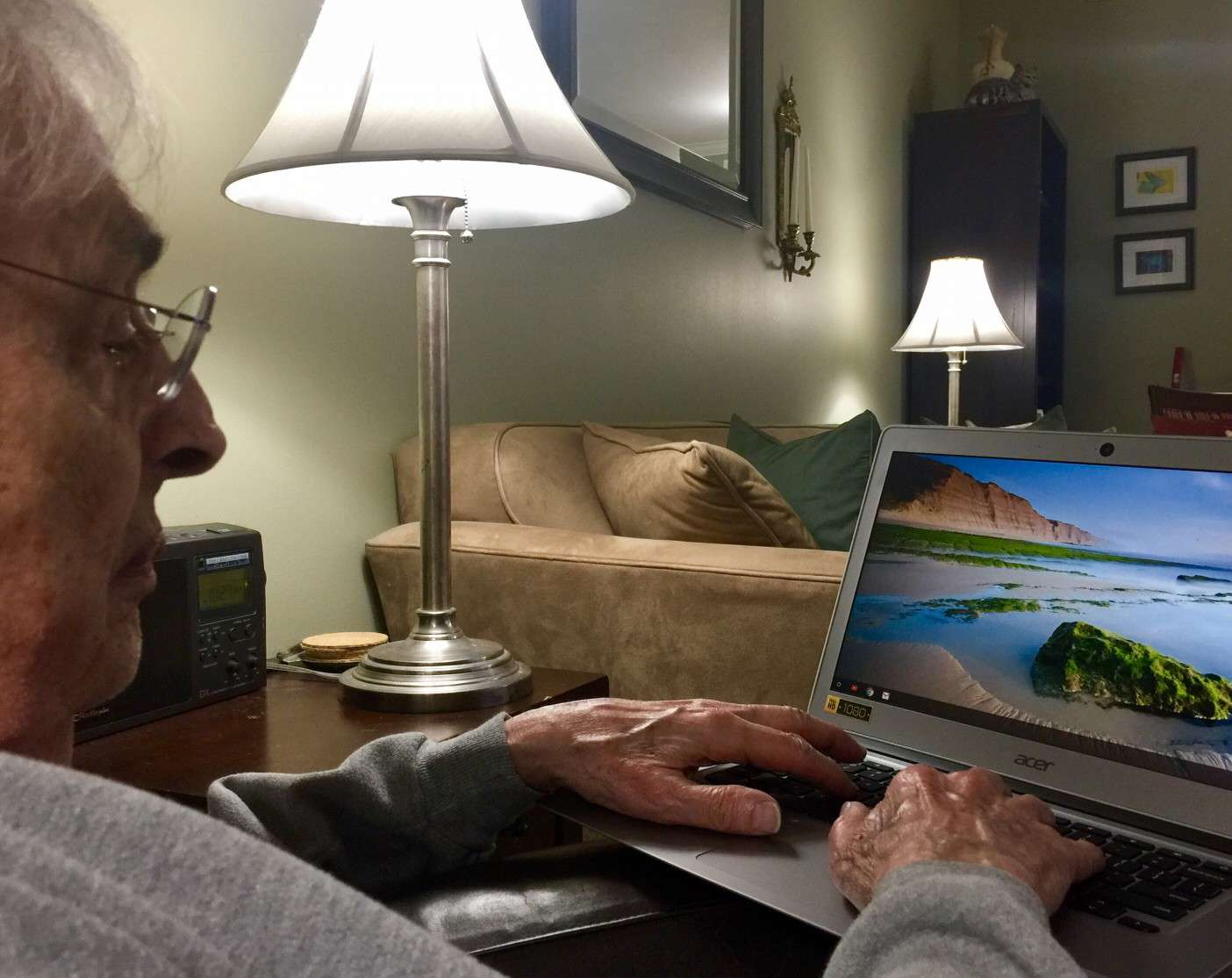 An older man using a Chromebook.