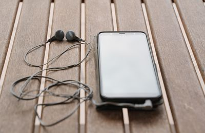 Smartphone with wired headphones.