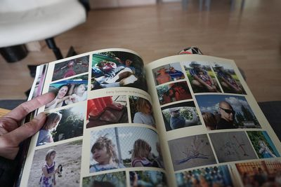 Person holding a photo album created and printed with online software