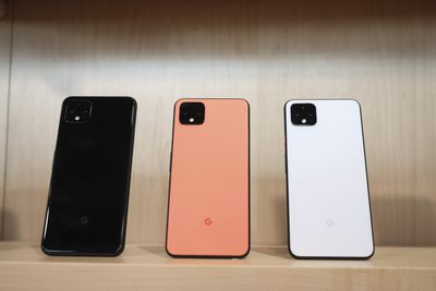 Google Pixel 4 smartphones in black, coral, and white