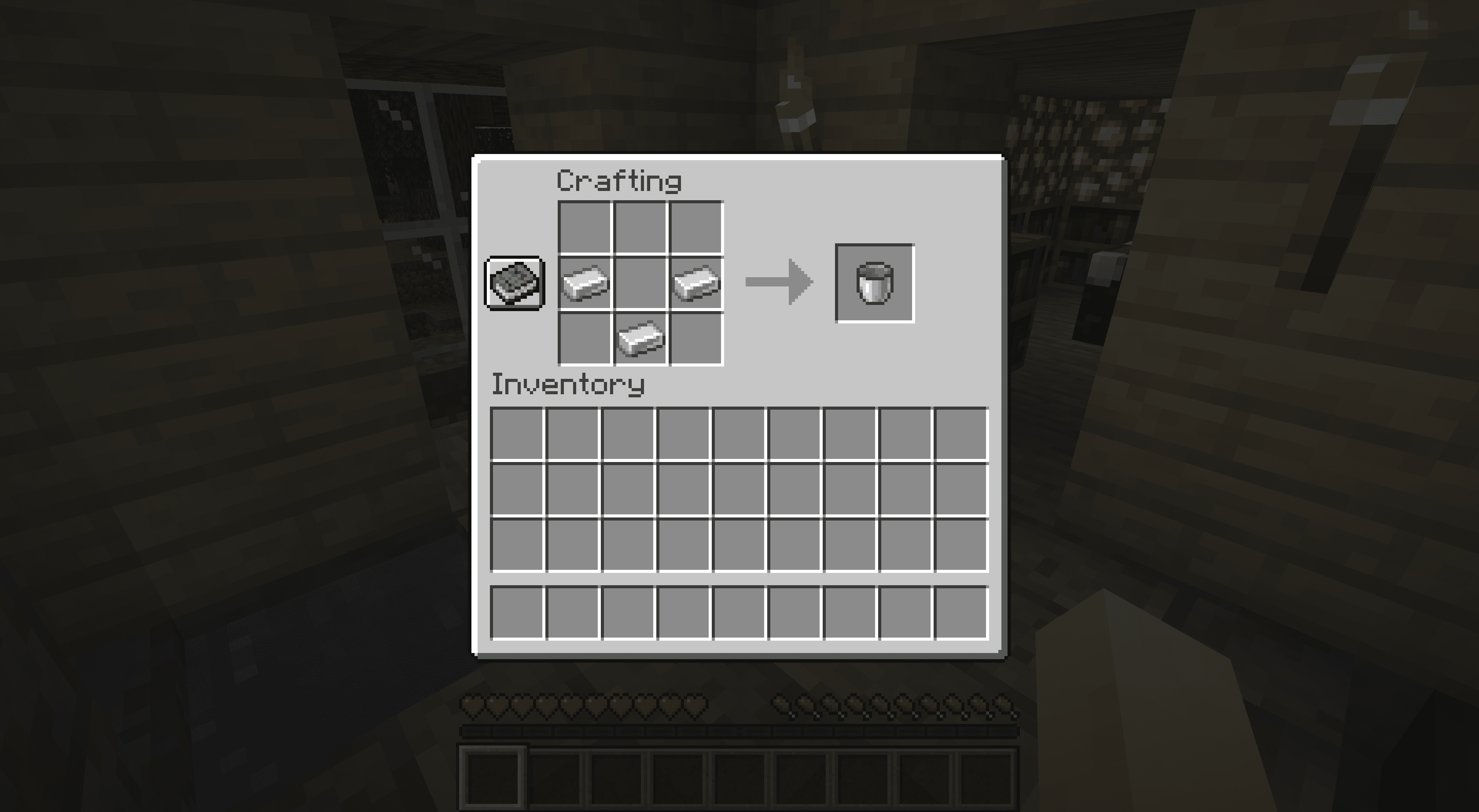 The bucket recipe in Minecraft.