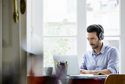 Man listening to music at desk