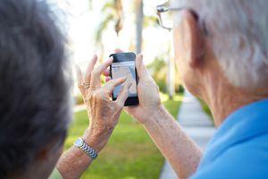 Seniors using digital device.