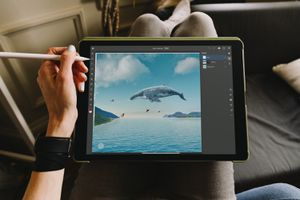 Person using iPad Pro and Apple Pencil with Photoshop