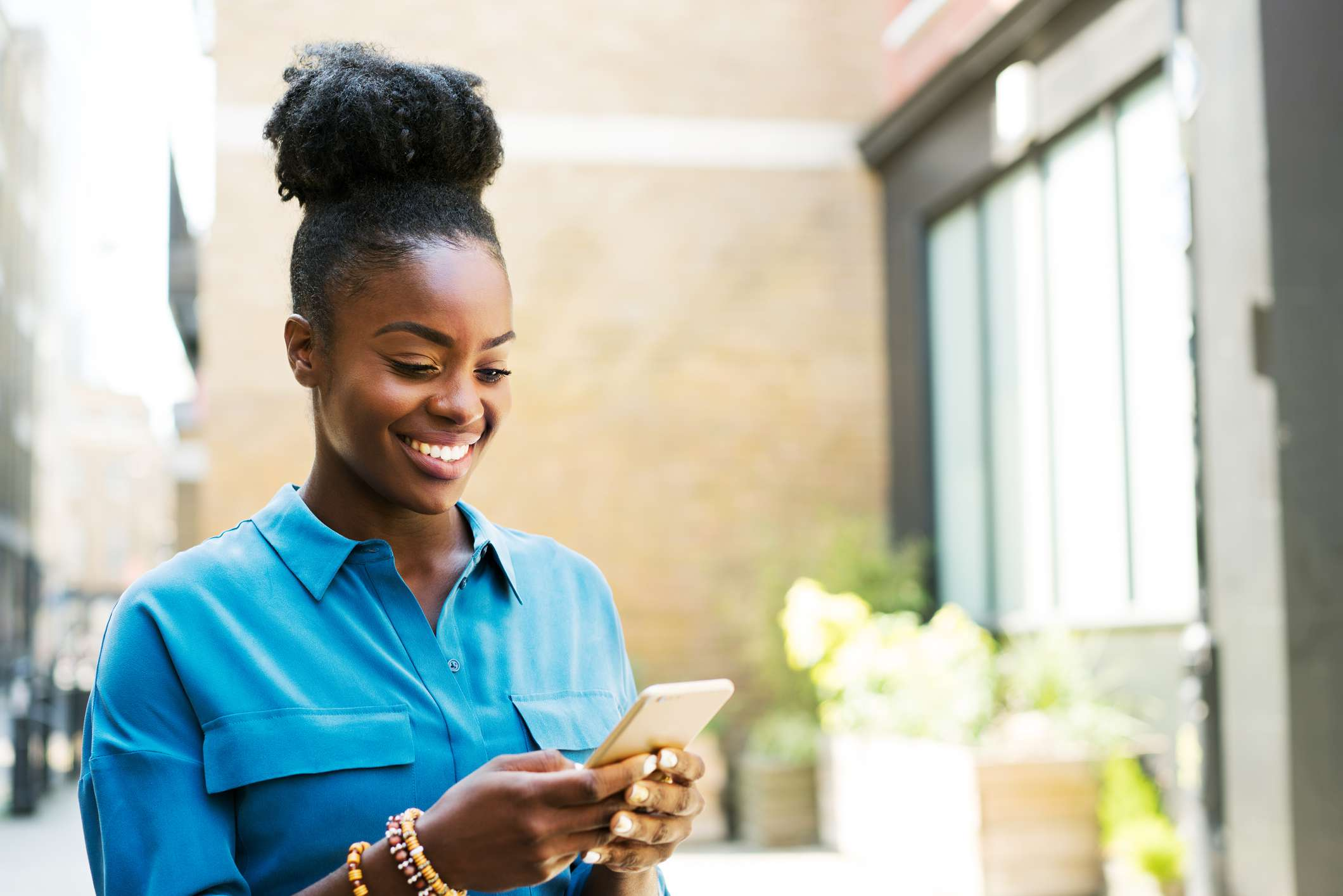 Smiling woman using smartphone