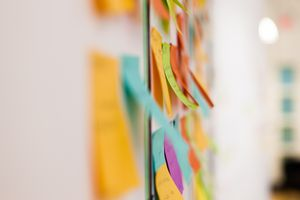 Multicolored sticky notes on whiteboard