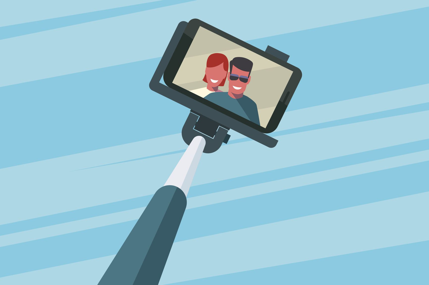A couple taking a selfie with a selfie stick.