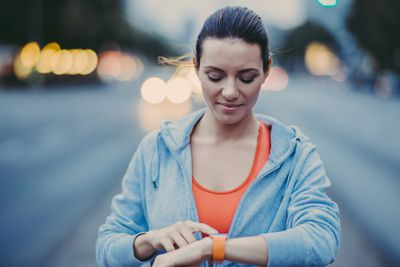Woman checking the time on a smartwatch