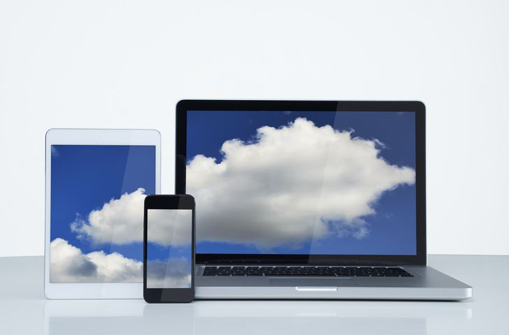 Digital devices illustrating cloud concept