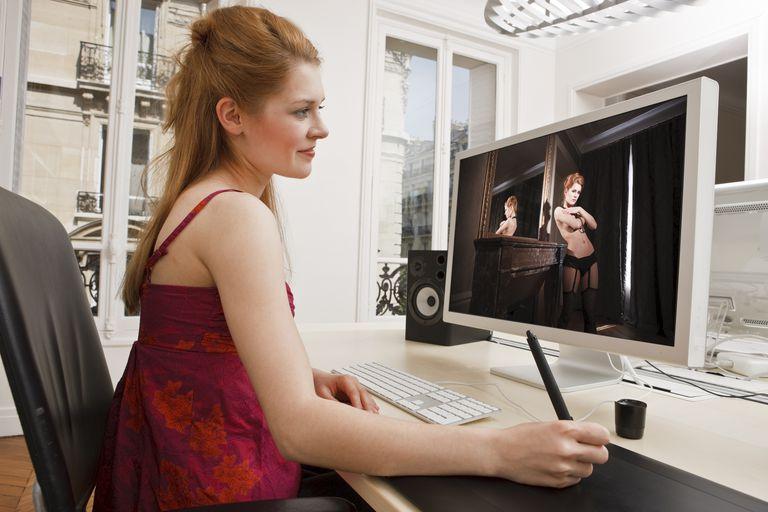 Woman retouching a photo on computer