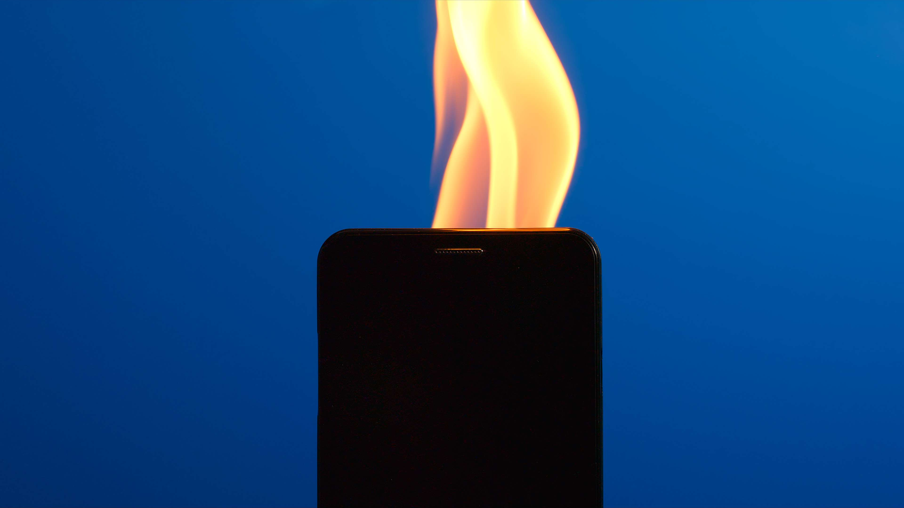 Silhouette of smartphone burning