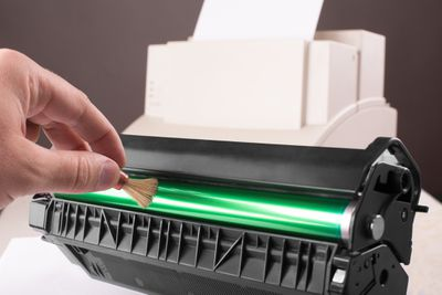 Cleaning a printer toner