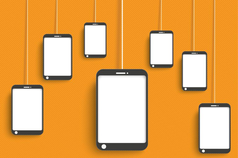 Smartphones dangling on orange background.