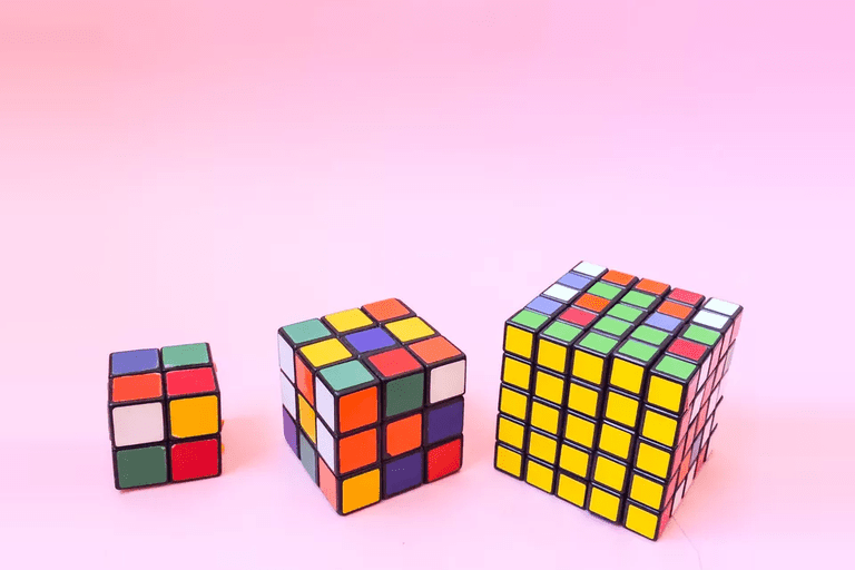 Picture of three Rubik's cubes that are different sizes