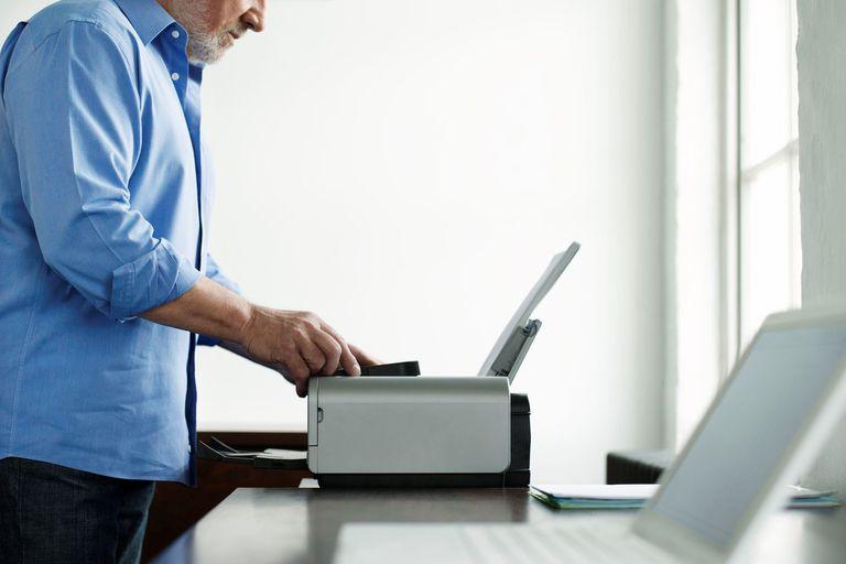 Man messing with printer