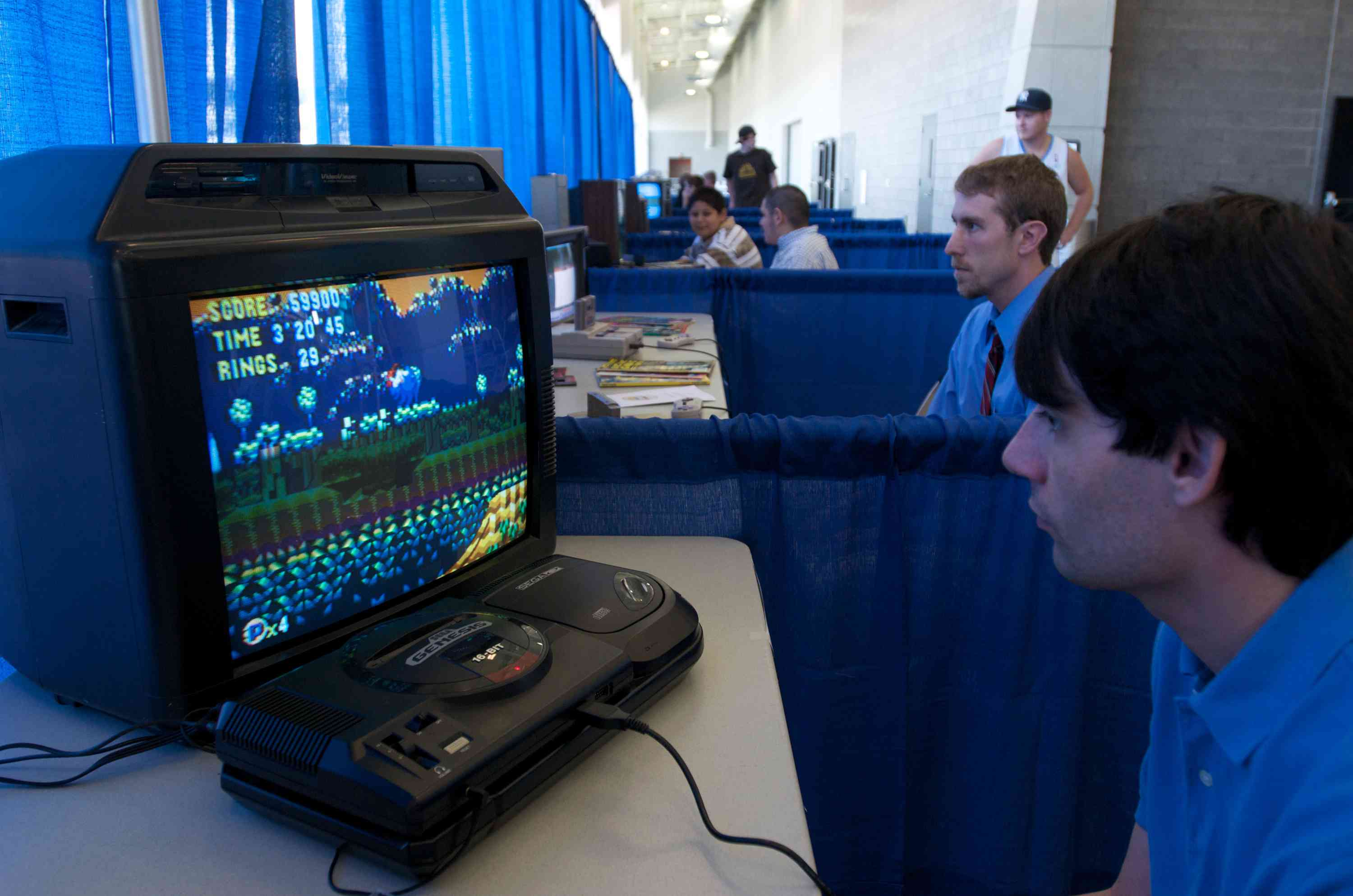 Matthew Murray of Ottumwa, Iowa plays Sonic the Hedgehog on an old Sega Genisis system at the launch party for the International Video Game Hall of Fame