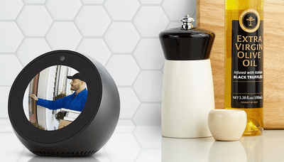 Black Amazon Echo Spot on Kitchen Counter Showing Video of Delivery Man at Front Door