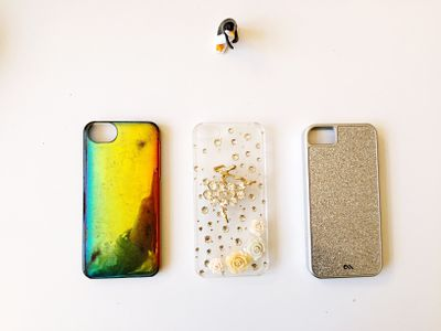 Three iPhone cases on a table
