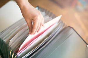 woman looking in physical file folders