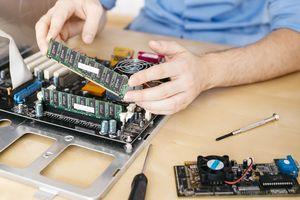 A man installs RAM in his computer.