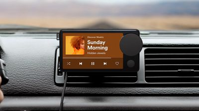 Spotify Car Thing mounted to the vent in a car