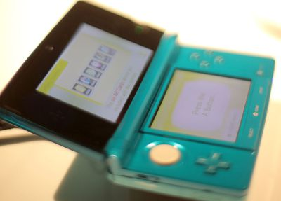 Close up of a teal Nintendo 3DS