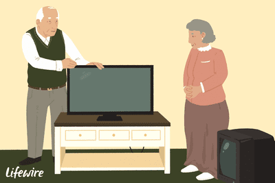 Two people setting up an HDTV