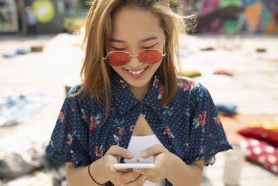 Social media influencer using smartphone