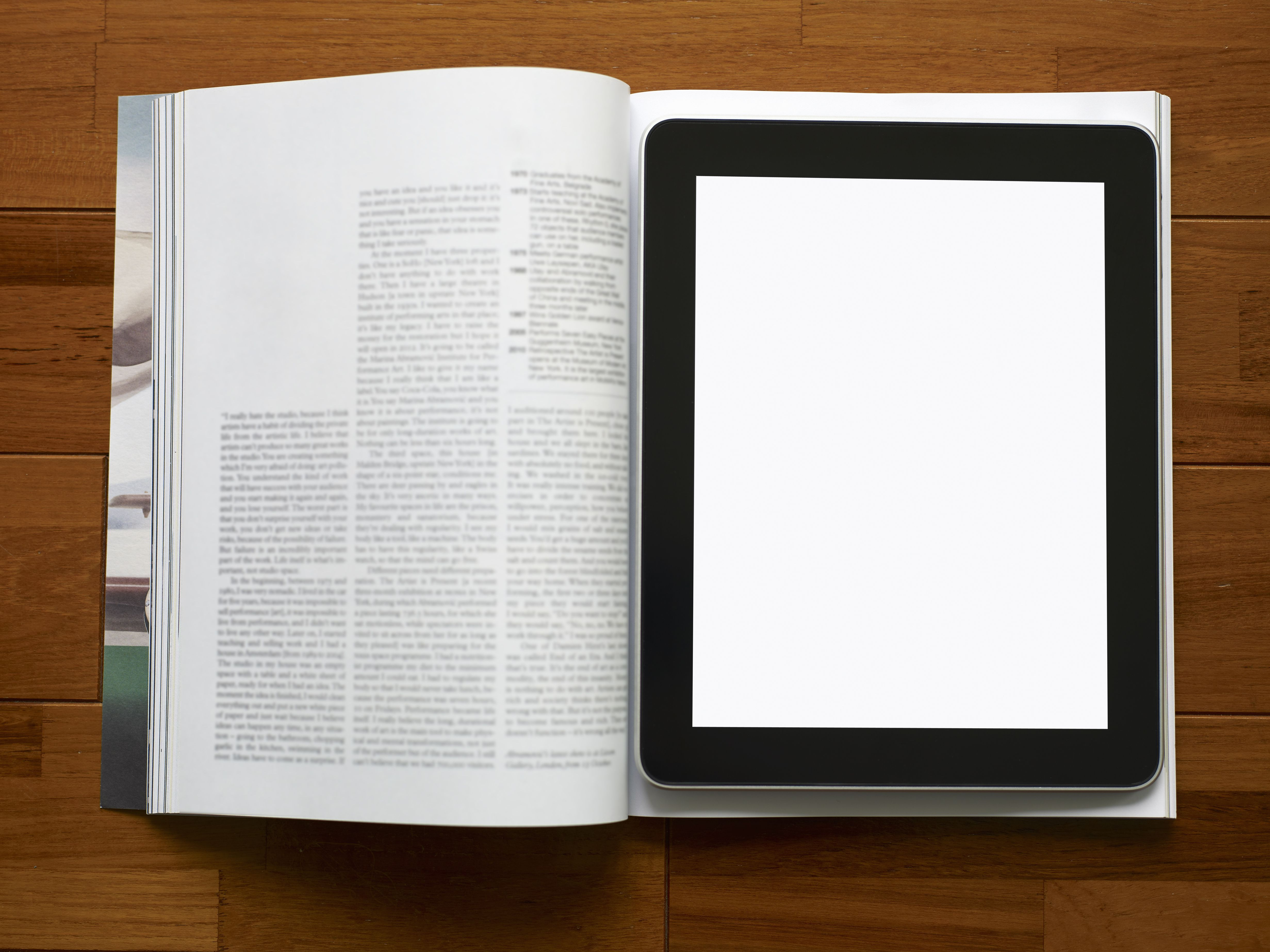 Tablet computer and magazine.