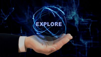 Digital planet around the word explore held in the palm of a hand