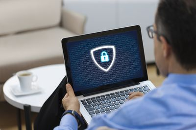 Man using computer with lock on the screen