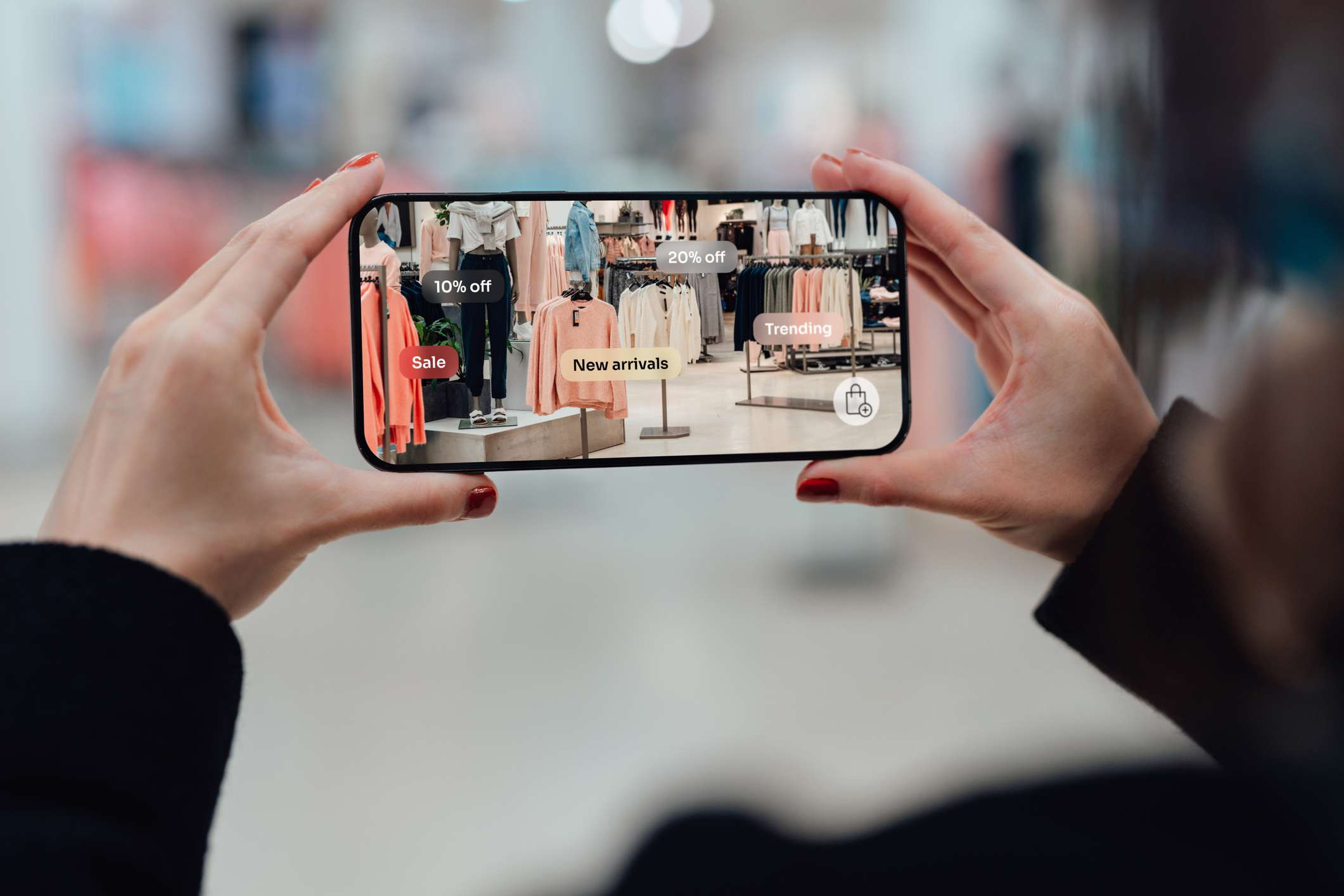 Someone using an augmented reality app while shopping at a clothing store.