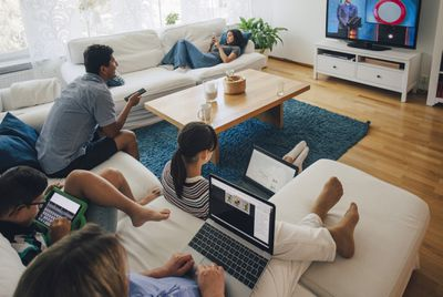 Image of guests in a living room using technology