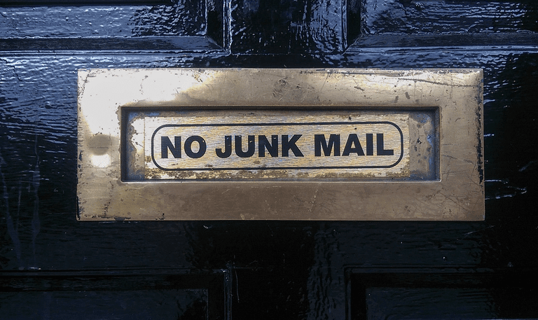 Image of a mail slot with a No Junk Mail label