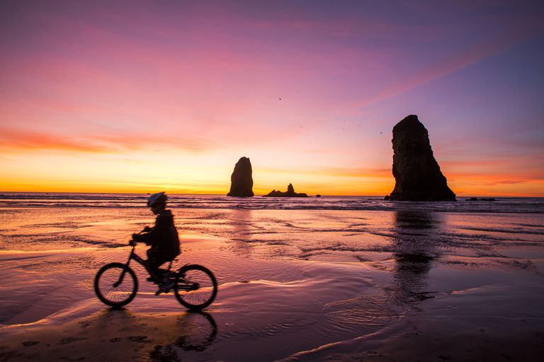 sunset bicycle ride on the beach