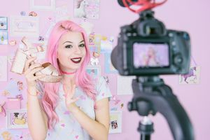 settings Female vlogger making social media video about fashion shoes for the internet