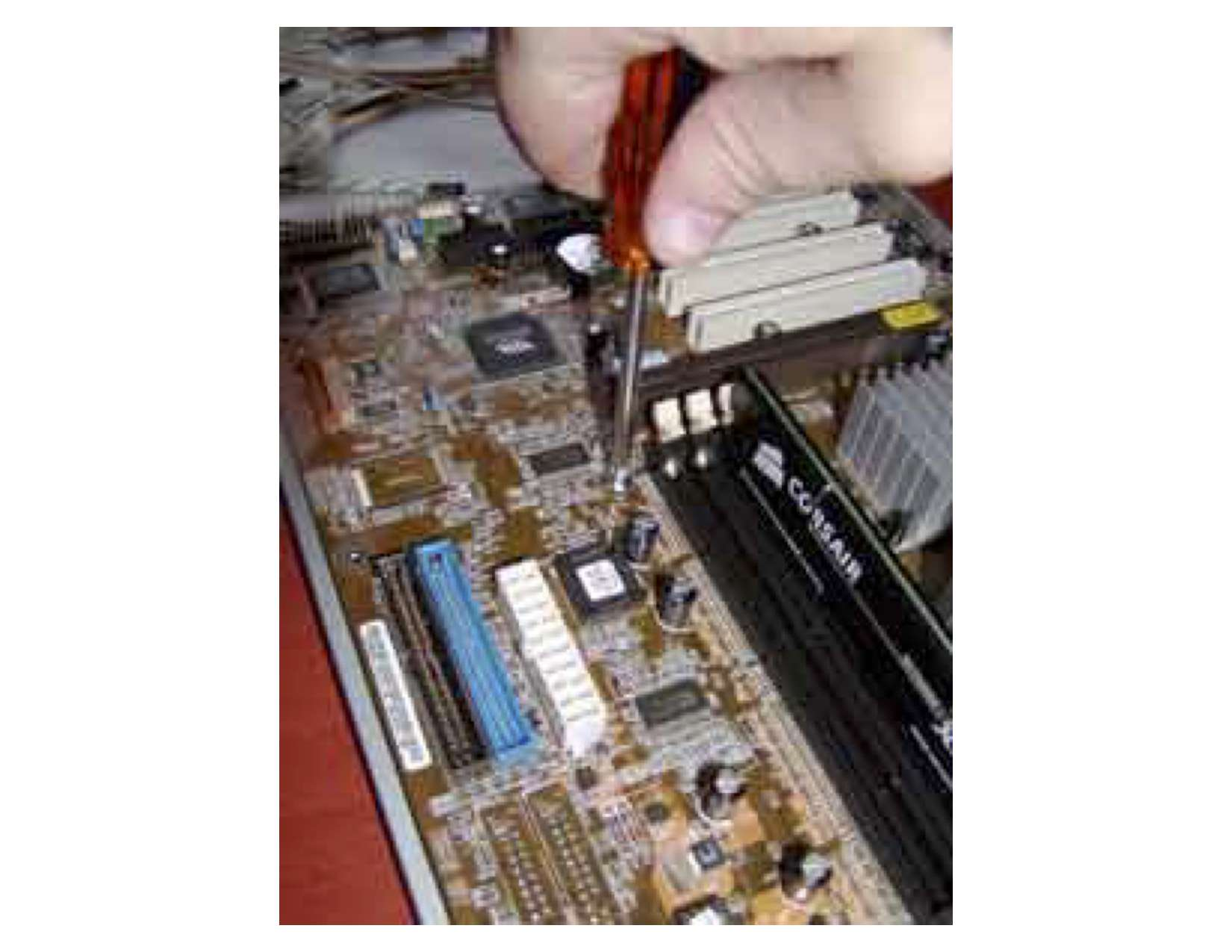 Screwing a motherboard onto the motherboard tray