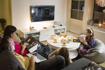 A family casts Apple TV+ to a TV using Chromecast.