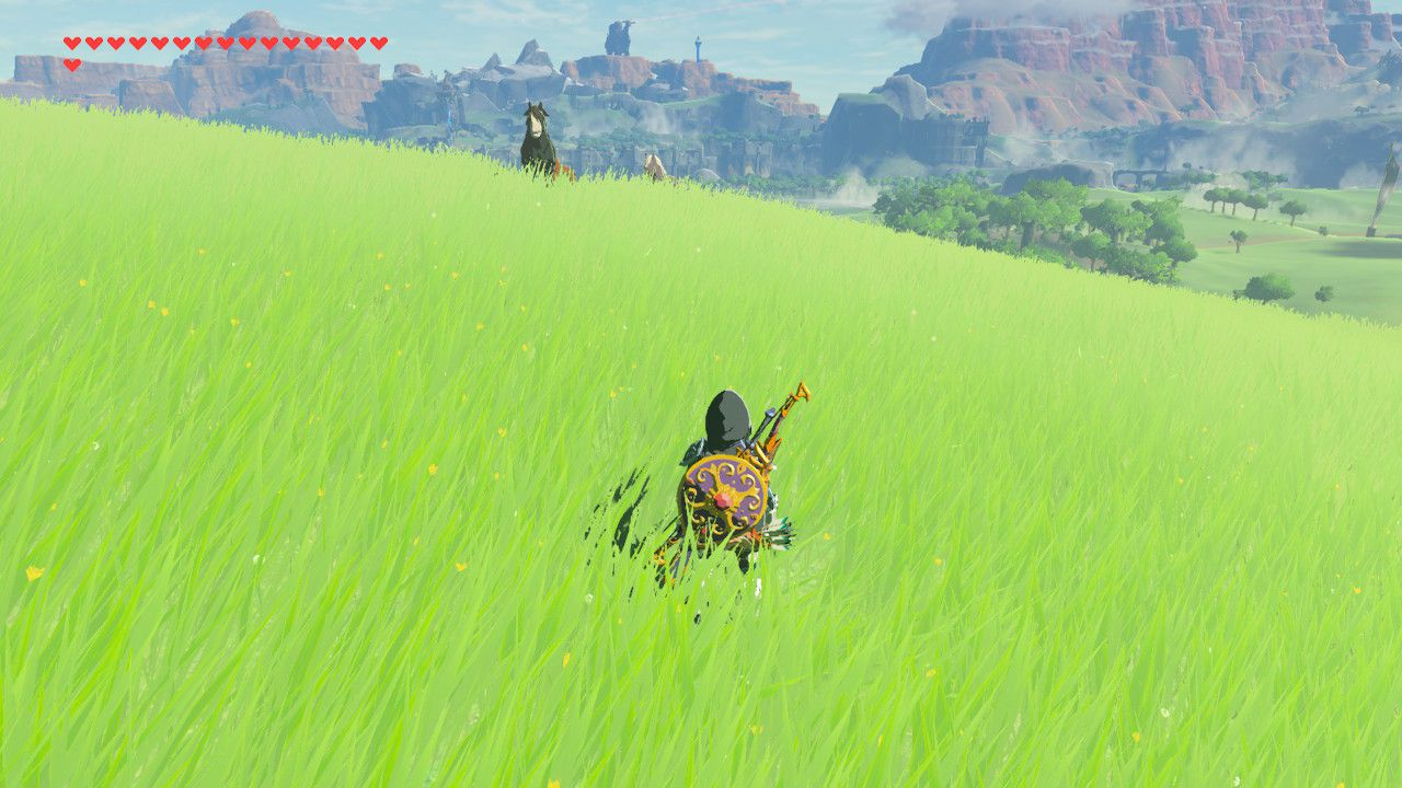 A group of horses grazing in Hyrule Field in Zelda: Breath of the Wild