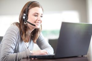 Woman with headset using speech to text software