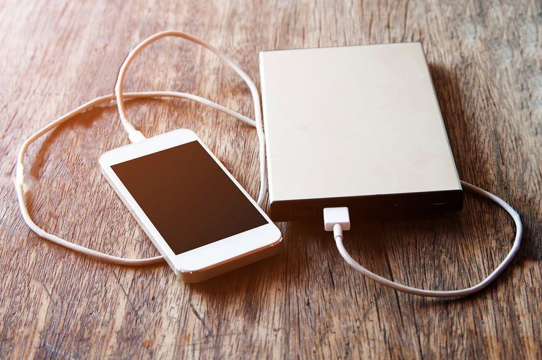 Close-Up of Smart Phone Connected to Portable Charger