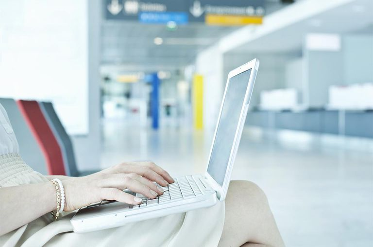 Woman using laptop in airport
