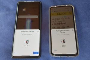 Two phones use Nearby Share to pass data.